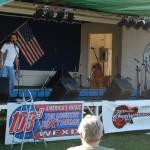 Dennis Harold of WkQS FM - Sunny 101.9 - Master of Ceremonies - Texaco Country Showdown - International Food Fest - Lower Harbor - Marquette, Michigan - July 5, 2012