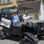 Adam and Todd N in the parade driving a mule from Zambon's of Marquette