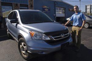 Nick LaFayette with the freshly repaired Honda CRV