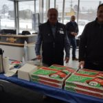 Jim standing with all the free Jet's Pizza at Frei Chevrolet
