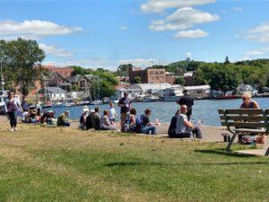 Spectators enjoy the Veteran Appreciation Fishing Day Boat Parade at HarborFest on WFXD 103.3