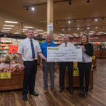 Super One Foods Marquette Store Manager Mike Levine, Todd Noordyk, Township Manager Randy Girard and Township Supervisor Lyn Durant.