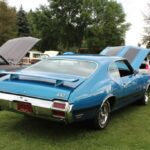 Rear shot of the bright blue Oldsmobile