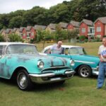 A Pontiac and a Chevy Bel Air side by side, both bright blue with white accents
